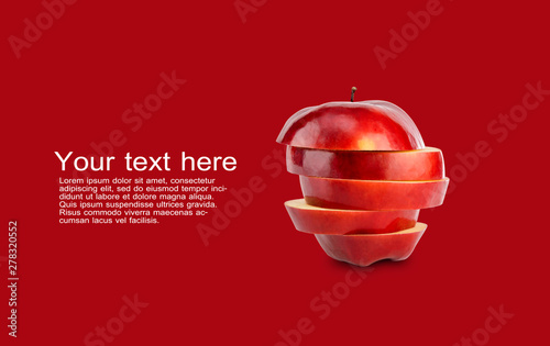 Stack of red apple sliced on red background with copy space and sample text Canvas-taulu