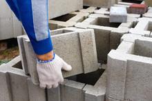 Worker Loads Cinder Blocks  Fr...