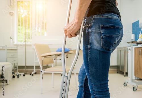 Injured man trying to walk on crutches in the hospital. Tapéta, Fotótapéta