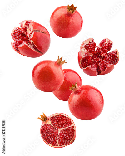 Falling pomegranate isolated on white background, full depth of field, clipping path