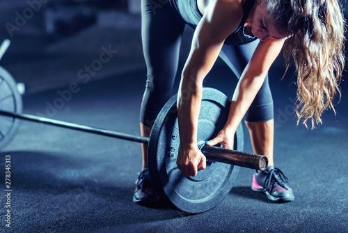 Fotografie, Obraz Woman weightlifting on training