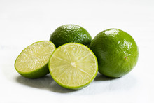 Fresh Green Limes On White Background