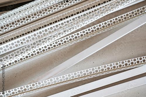 Fotografija perforated plastic corner for gypsum plasterboard, fixing plasterboard, building