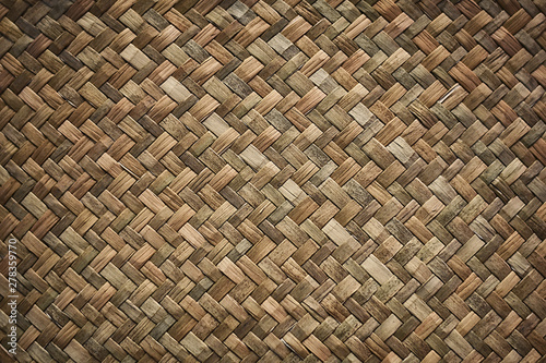 Natural wicker braided woven rattan Sedge grass texture background Fototapet