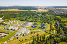Aerial View Of Sewage Treatment Plant. Industrial Water Treatment For Big City From Drone View. Waste Water Management.