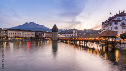 Fotografie, Obraz Old wooden architecture called Chapel Bridge in Luzern