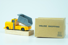 A Yellow Toy Dump Truck With C...