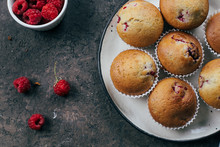 Raspberry Muffins On Light Concrete Background. Top View, Flat Lay