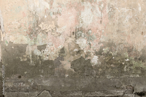 Photo sur Toile Vieux mur texturé sale old shabby damaged plaster on the walls of houses close-up