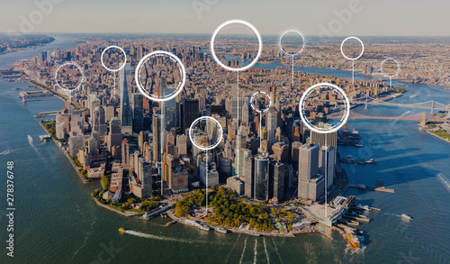 Photo Stands New York Technology digital circle with aerial view of Manhattan, NY skyline