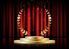 Golden Laurel Wreath Over Red Round Podium With Steps In Front Of The Curtains.