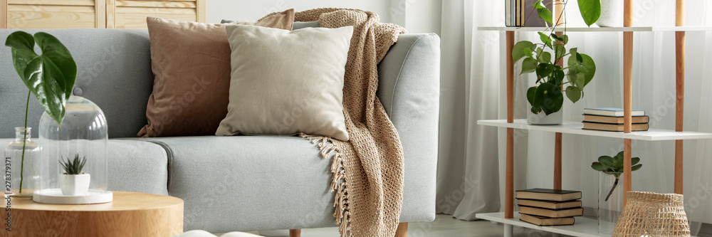 Fototapety, obrazy: Close-up of gray comfortable sofa in modern apartment - panorama