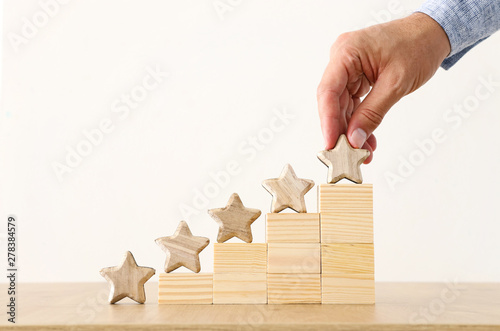 business concept image of setting a five star goal. increase rating or ranking, evaluation and classification idea - 278384579