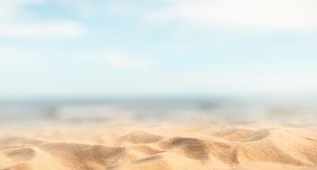 Fototapeta na wymiar Tropical summer sand beach and bokeh sun light on sea background, copy space.