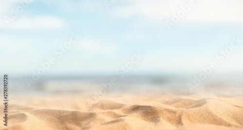 Foto auf AluDibond Licht blau Tropical summer sand beach and bokeh sun light on sea background, copy space.