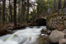 Stone Bridge And Waterfalls Un...
