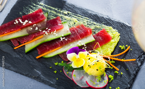 Raw tuna sashimi with cucumber and avocado sauce