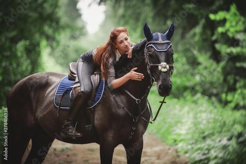 Fotografie, Tablou  portrait of attractive woman and black hanoverian stallion horse