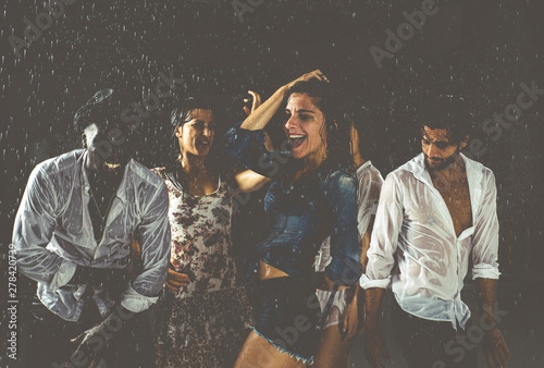 Group of friends dancing in the rain - 278420739