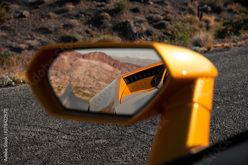 Fototapeta  Empty Road Visible in Sports Car Mirror