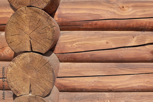 Foto auf Gartenposter Brennholz-textur Texture of a brown log house. Wooden background with copy space