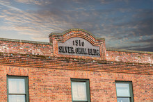 An Old Brick Building With 191...