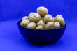 canvas print picture - Baby potatoes in a black bowl against a colourful back drop. Calgary, Alberta, Canada