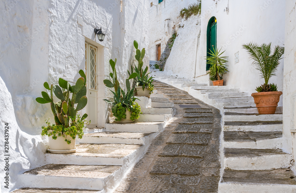 Fototapeta Scenic sight in Ostuni in a sunny summer day, Apulia (Puglia), southern Italy.