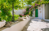 Fototapeta Na drzwi - Scenic sight in Ostuni in a sunny summer day, Apulia (Puglia), southern Italy.