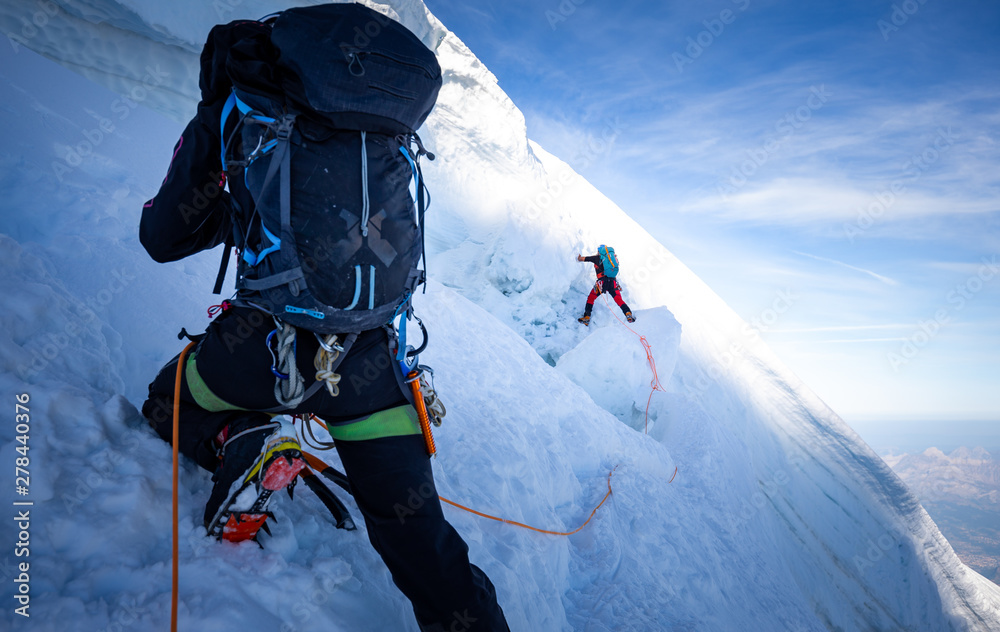 Fototapety, obrazy: Two mountaineers climb steep glacier ice crevasse extreme sports, Mont Blanc du Tacul mountain, Chamonix France travel, Europe tourism.