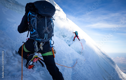 Two mountaineers climb steep glacier ice crevasse extreme sports, Mont Blanc du Tacul mountain, Chamonix France travel, Europe tourism Wallpaper Mural