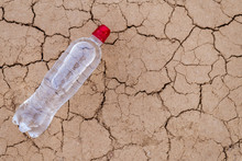 A Bottle Of Water On The Dried...