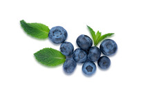Closeup Blueberry Berries With Mint Leaves Isolated On White Background. Photo Of Blueberry For Designers On The Banner. Useful Berries For Sight