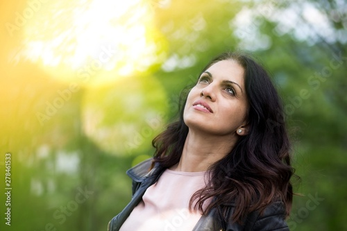 Obraz na plátne  Beautiful middle-age woman in black leather jacket smiling