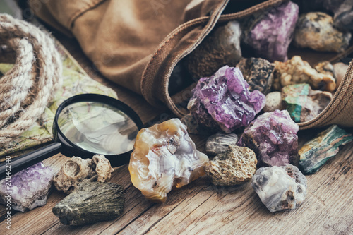 Mineral stones collection and kit of geologist - backpack, map, magnifying glass, rope.