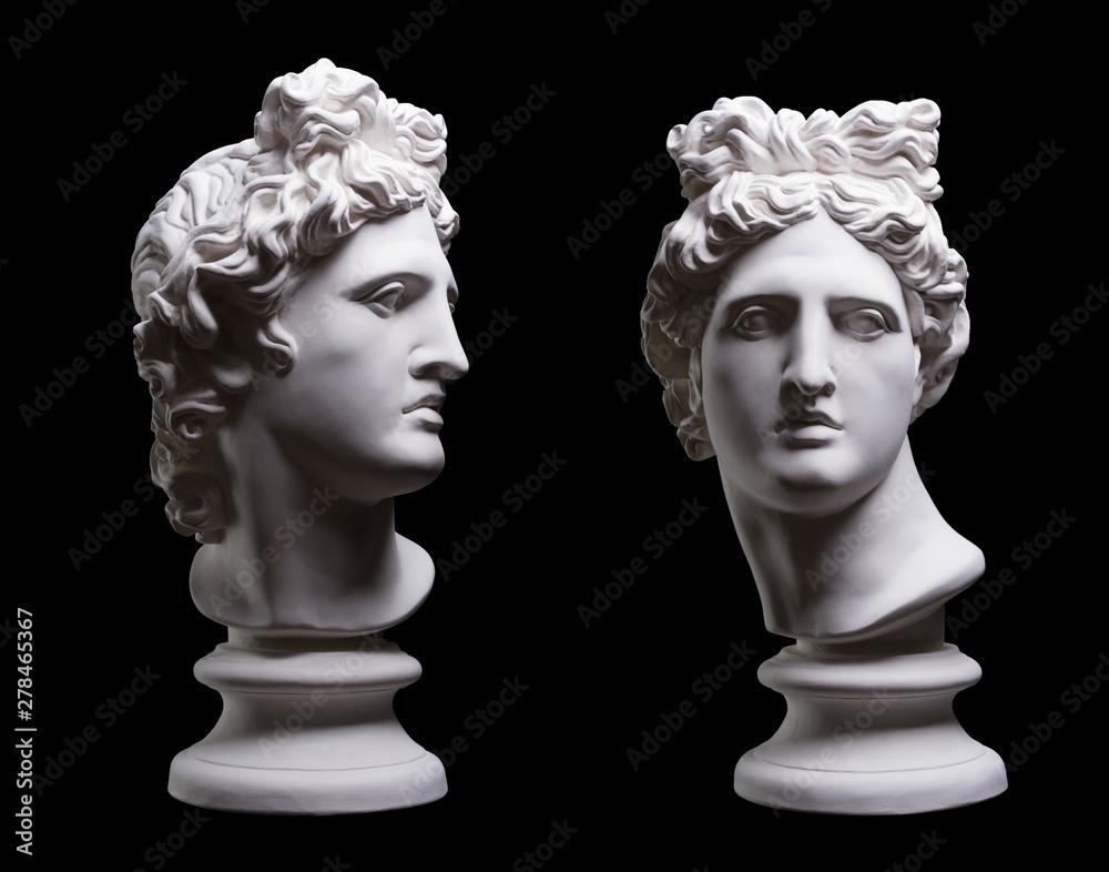 Fototapeta Statue. On a black isolated background. Gypsum statue of Apollo's head. Man.Statue. On a black isolated background. Gypsum statue of Apollo's head. Man.