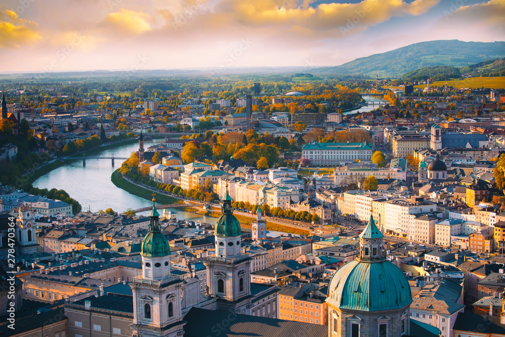 Fototapeta Beautiful of Aerial panoramic view in a Autumn season at a historic city of Salzburg with Salzach river in beautiful golden evening light sky and colorful of autumn at sunset, Salzburger Land, Austria