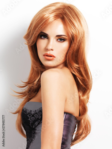 Beautiful woman with long straight red hair Canvas Print