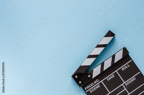 Movie clapper board on blue background for filming equipment Canvas Print