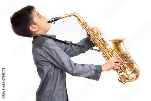 Fotografía Little asian musician boy playing saxophone instrument