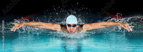 Photo  Man in swimming pool. Butterfly style