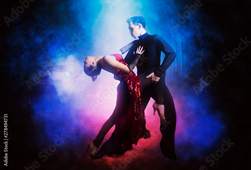 Pair of dancers dancing ballroom - 278494731