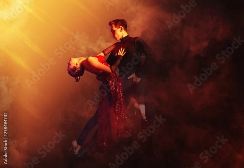 Fototapeta Pair of dancers dancing ballroom