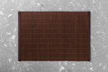 Empty Asian Food Background. Dark Bamboo Mat On Wooden Background Top View With Copy Space Flat Lay