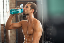 Fitness Man Drinking From Wate...