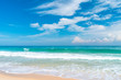Beautiful tropical beach with blue sky and white clouds abstract texture background. Copy space of summer vacation and holiday business travel concept.
