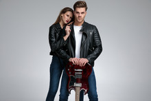 Motivated Casual Couple Posing While She Is Leaning On Him