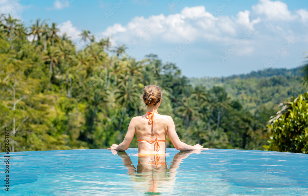 Fototapety, obrazy: Woman in tropical vacation enjoying the jungle from the pool