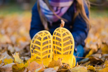 Sole Of Yellow Gumboots At Leaves Close Up