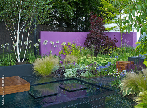 A Colourful Modern Garden Design With A Range Of Flowers Plants And Shrubs Decking Water And Architectural Features Buy This Stock Photo And Explore Similar Images At Adobe Stock Adobe Stock